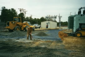 Distribution and finishing of top-off landscaping material to support the needs of this power substation