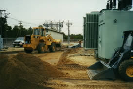 Utility Site early phase, moving material to prepare for underlayment of environmental barrier material
